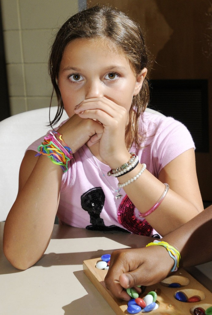 Janelle Sperdakos, 10, waits her turn while playing Mancala. Silly Bandz, essentially rubber bands that retain specific shapes, are the products of BCP Imports of Ohio.