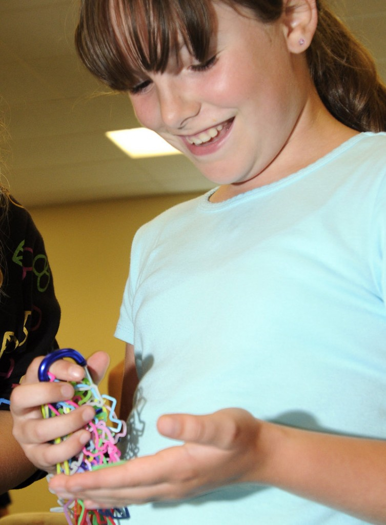 Molly Bowden, 9, looks through her collection of Silly Bandz. She keeps about 45 of them on a key chain.