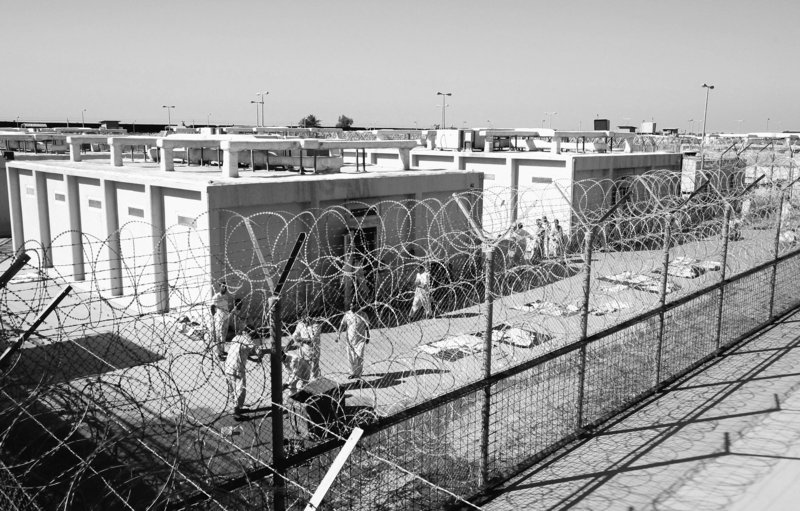 Detainees are seen outside their cell block in 2008 at the U.S. detention facility at Camp Cropper in Baghdad, Iraq. As of today, Camp Cropper will be run by the Iraqi government.