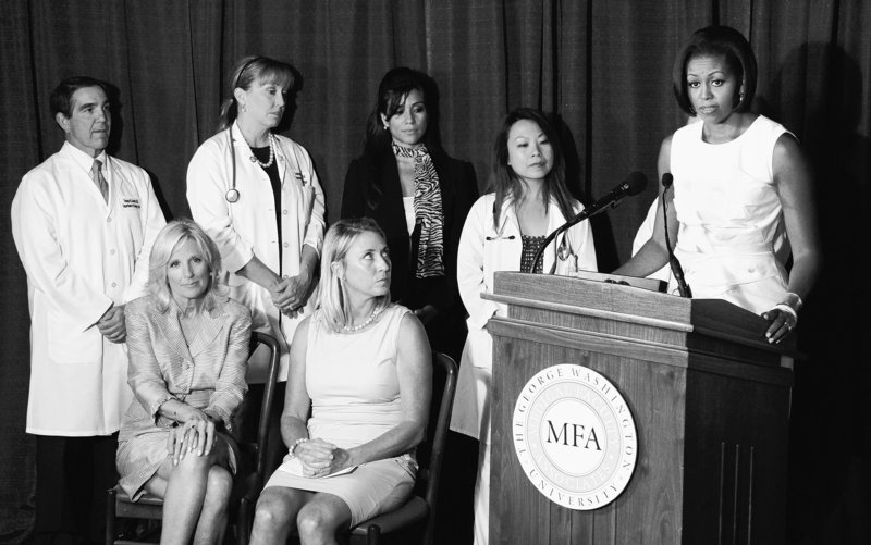 First lady Michelle Obama, right, speaks Wednesday about the Affordable Care Act's preventive coverage. With her are Jill Biden, the vice president's wife, seated at left, and hospital staff at George Washington Medical Faculty Associates in Washington.