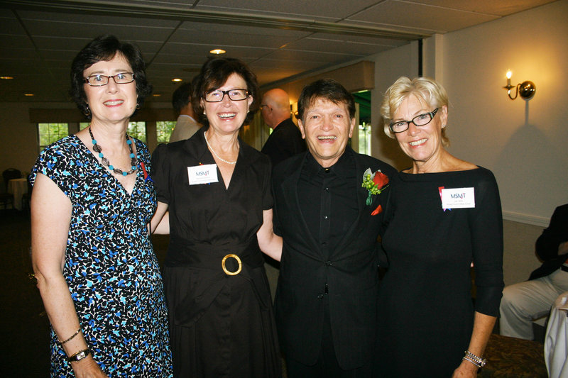 Retiring artistic director Charles Abbott, sharing a laugh with some of the women who made the party possible. They are Nancy Ladd, Barbara Norton and Jan Wilk, chair of the board.