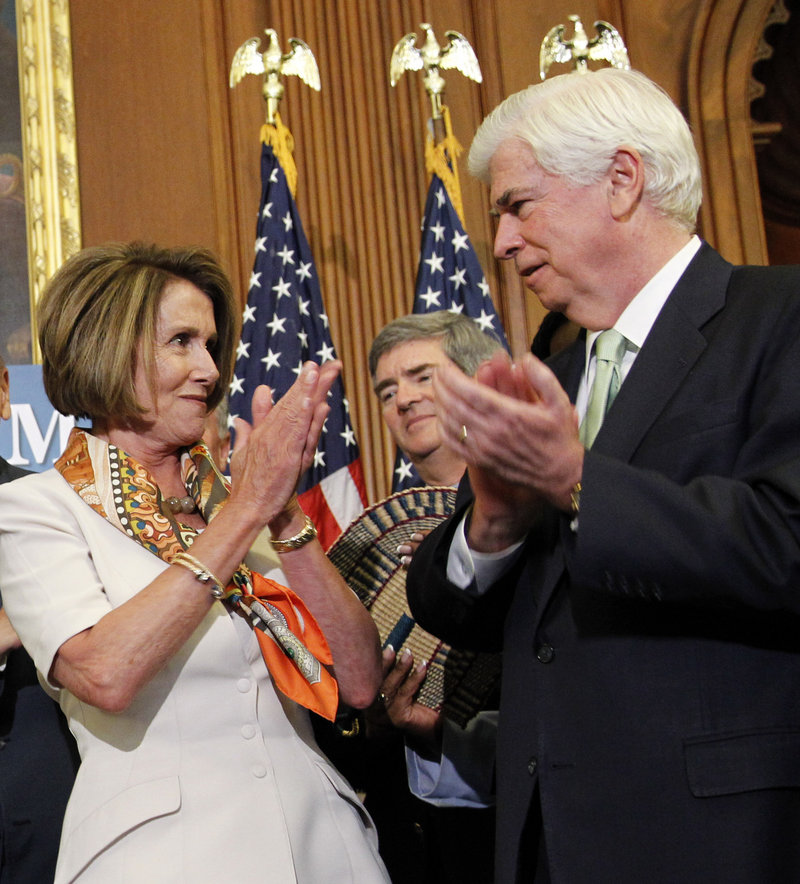 House Speaker Nancy Pelosi, D-Calif., applauds with Sen. Christopher Dodd, D-Conn., after signing the financial reform legislation bill during a ceremony on Capitol Hill Thursday.