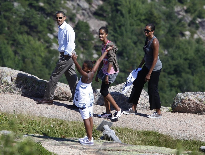 President Obama, first lady Michelle Obama, and daughters Malia, back, and Sasha visit Cadillac Mountain in Acadia National Park on Friday, the first day of their weekend getaway to Maine.