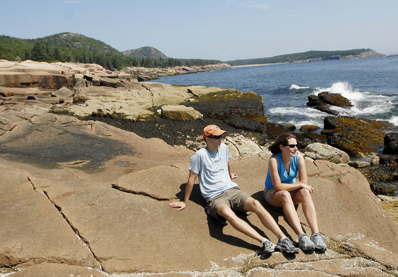 Ed and Cate Fitzgerald of Glens Falls, N.Y., take in the view from the rocky coast at Acadia National Park on Saturday. The Fitzgeralds found out on the way to Maine that their trip to the park would coincide with the visit of President Obama and his family.