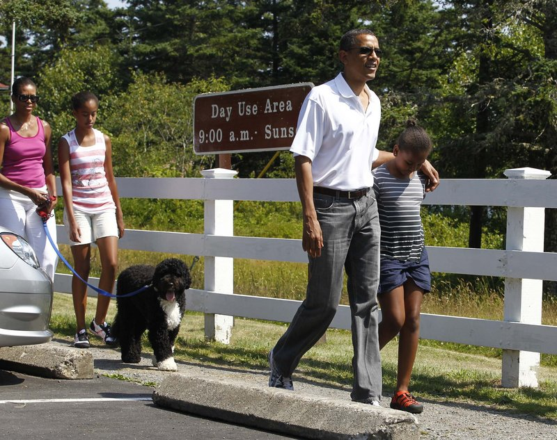 President Obama and his daughter Sasha lead the way as the first family walks toward the Bass Harbor Head Lighthouse on Saturday. They're followed by Bo, first lady Michelle Obama and older daughter Malia.
