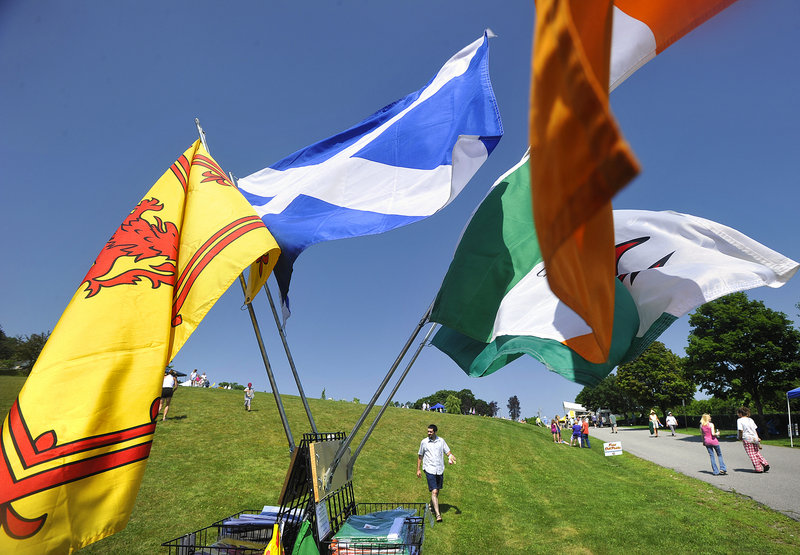 Flags billow in the breeze Saturday outside a tent selling Celtic ware.