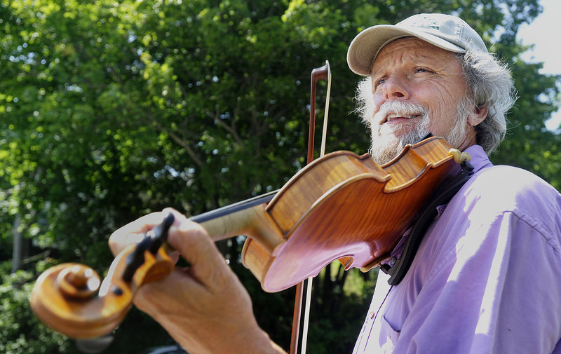 Fiddler Barry Crawford bows a tune at a fiddling workshop on Saturday afternoon. Crawford, who lives in Monroe, is a member of the Belfast Bay Fiddlers band, which will take the stage this morning.