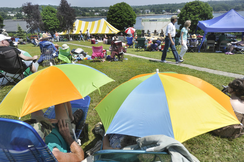 Colorful umbrellas and lawn chairs litter the lawns on Belfast Common Saturday as Celtic music lovers listen to musicians on the music stage at the festival.