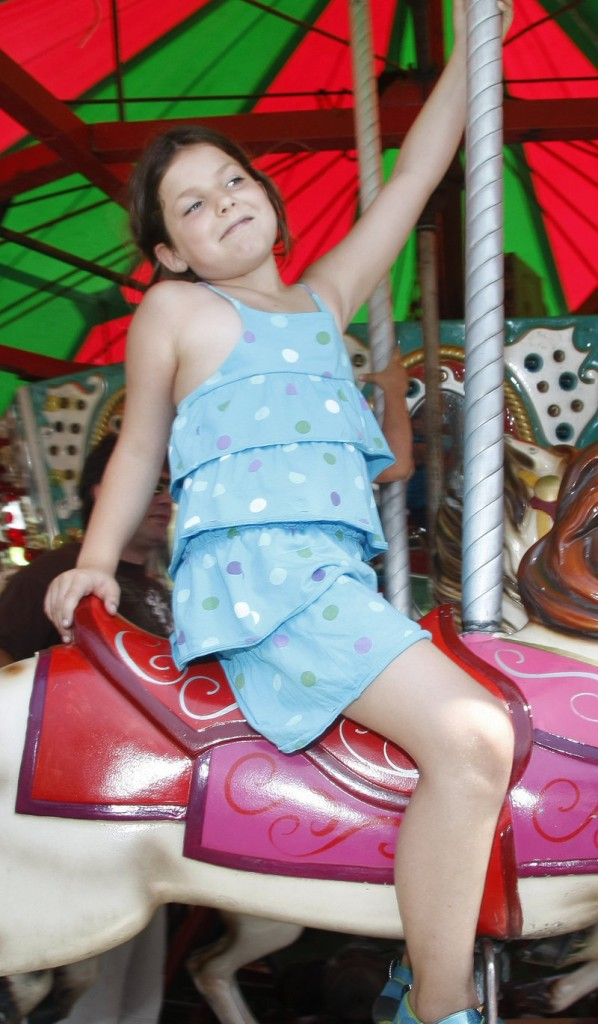 Alonna Hanneman, 7, of Kennebunk enjoys a merry-go-round ride, one of the many fun things to do at the festival.
