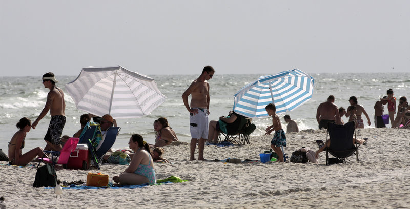 Visitors crowd the beach Saturday in Gulf Shores, Ala., where tourism has picked up since BP confirmed Thursday that oil had stopped flowing into the Gulf of Mexico.