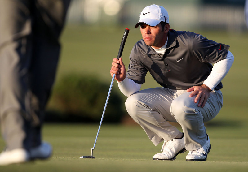 Paul Casey, lining up a putt on the 17th green Saturday during the third round of the British Open, is alone in second place and four shots behind Louis Oosthuizen, but remains hopeful of making a run in the final round today at St. Andrews.