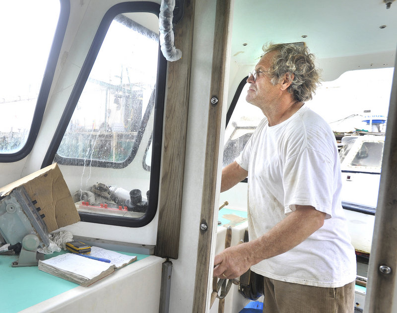 "Yarmouth lobsterman Willis Spear pilots his boat Tuesday in Portland Harbor. Spear organized 70 fishermen to sign a petition bound for City Hall on Monday in opposition to a proposal to allow pier owners to lease more space to pleasure boats. ""If you don't take a stand somewhere,"" Spear said, ""people take advantage of you."""
