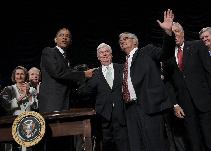 President Obama points to Sen. Chris Dodd, D-Conn., center, and Rep. Barney Frank, D-Mass., right, after signing the Dodd-Frank Wall Street Reform and Consumer Protection Act.