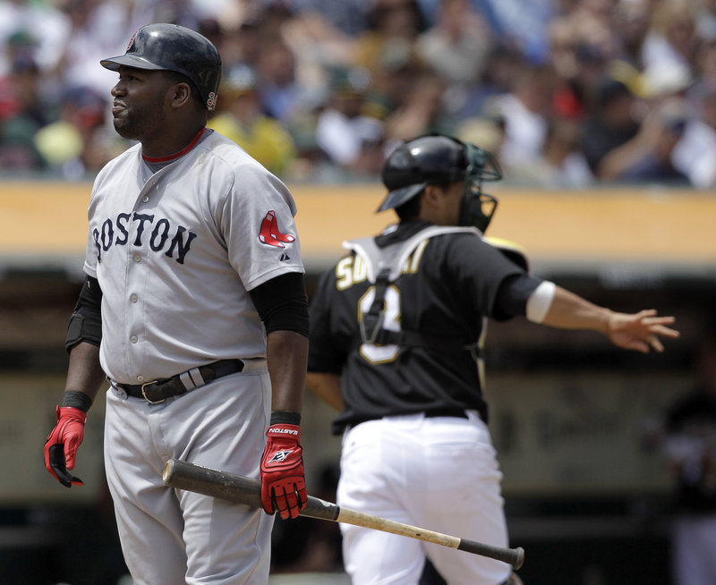David Ortiz of the Boston Red Sox reacts Wednesday after striking out to end the top of the fifth inning with a runner on second. The Oakland catcher is Kurt Suzuki. The Red Sox are 2-5 since the All-Star break and seven games behind the New York Yankees.