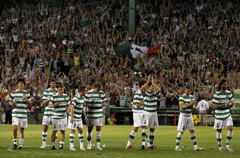 With the game over, members of the Celtic soccer team of Scotland applaud the Fenway Park crowd Wednesday night after beating Sporting Lisbon on penalty kicks.