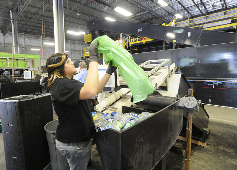 Jade Wildes dumps a bag of returnables into the sorter.