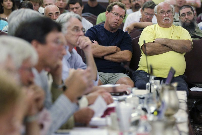 Lobstermen Joe Horvath of Belmont, N.J., right, and Tom Viesiadecki of Point Pleasant, N.J., listen during a meeting of the American Lobster Management Board in Warwick, R.I., on Thursday.