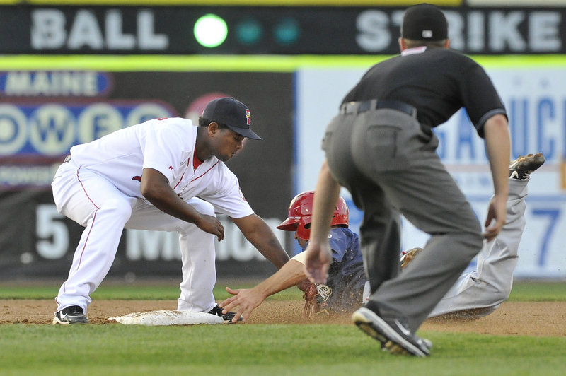 Yamaico Navarro of the Portland Sea Dogs slaps a tag on Danny Espinosa of the Harrisburg Senators, who was caught trying to steal second in the third inning Thursday night.