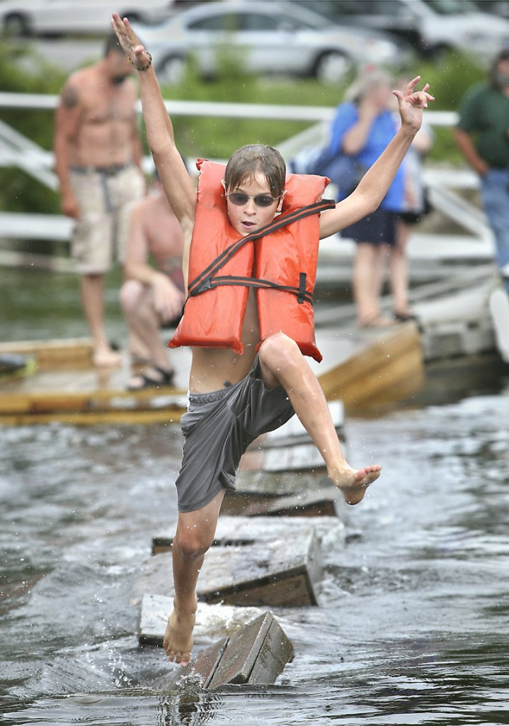 Jack Hartford, 11, of Richmond competes in the lobster crate races during Richmond Days at Fort Richmond Waterfront Park on Saturday.