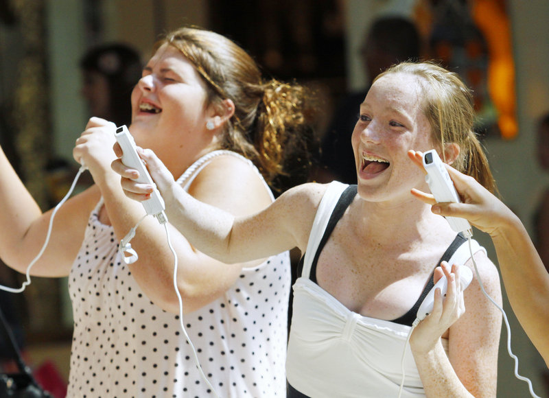 Michelle Rosselle, 14, left, and Nicole Cela, 16, both of Boston, compete in