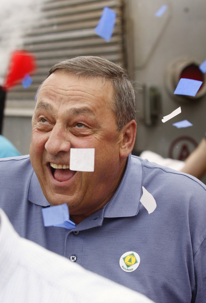 Confetti falls on Republican Paul LePage during a gubernatorial campaign stop in Bath.