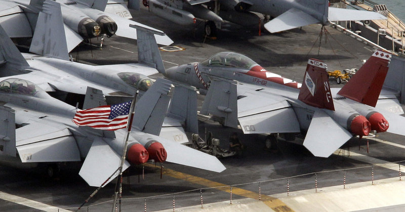 Fighter jets await action aboard the USS George Washington in Busan, South Korea. North Korea warned Saturday that joint U.S. and South Korean military exercises this weekend amount to a military provocation that will draw a