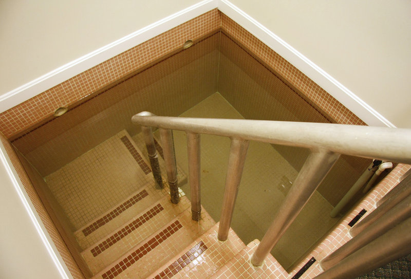 The Portland mikvah is a tiled tub of water accessed by walking down a set of stairs from a platform.