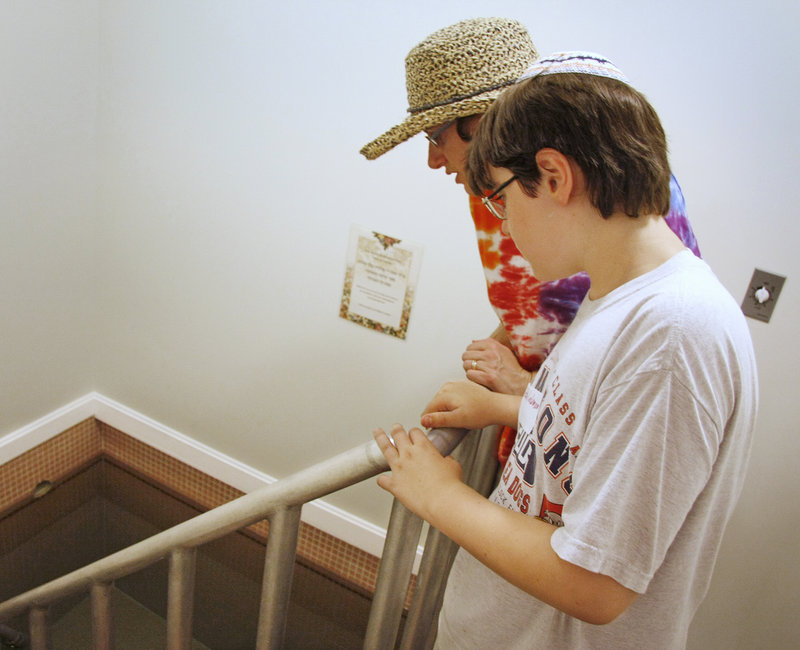 Rori Lockman of Gorham and her son, Teddy, 11, check out the mikvah that opened Sunday at Temple Shaarey Tphiloh in Portland for the first time after renovations.