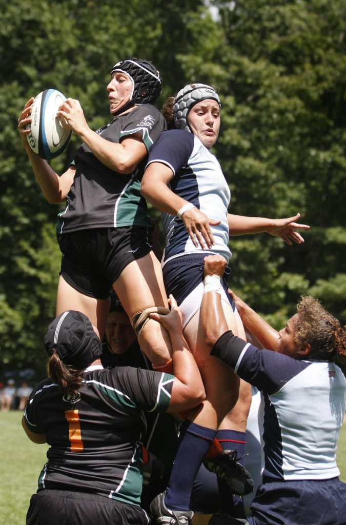 Farrah Douglas, far right at bottom, is part of the U.S. women's national rugby team spending a rare three weeks together at Bowdoin College, preparing for the World Cup next month in England.