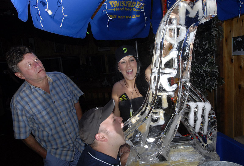 Bridgett Lynn, center, pours a drink down the Monster Luge and into the mouth of Tim McCaie of Massachusetts as Frank Ouellette, left, watches at Lindbergh's Landing on the Pier in Old Orchard Beach.