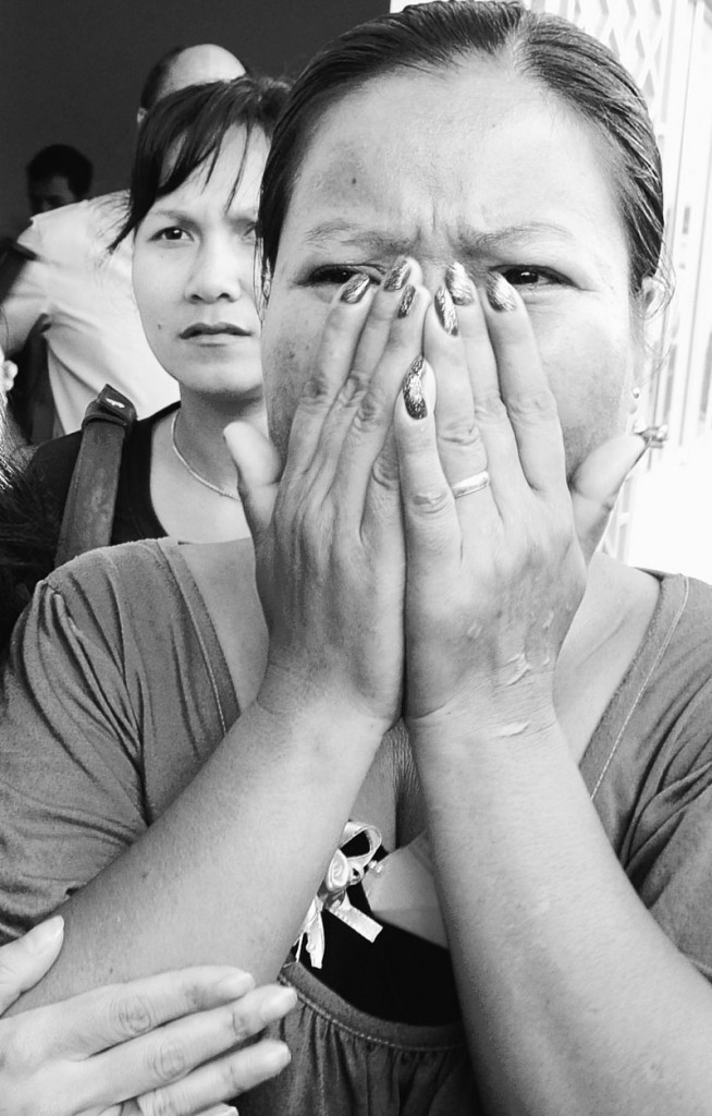 Cambodian victim Hong Savath, 47, weeps after the sentencing of Kaing Guek Eav, also known as Duch.