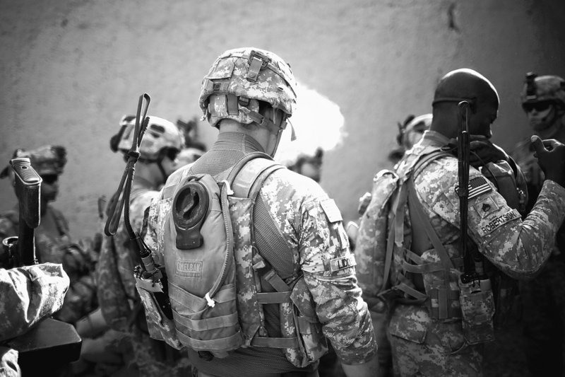 """U.S. soldiers with the 101st Airborne Division prepare for a patrol near Combat Outpost Nolen, in the volatile Arghandab Valley near Kandahar, Afghanistan, on Monday. Afghans seem little surprised over information posted by WikiLeaks, although President Hamid Karzai was """"shocked"""" at the number of documents leaked, a spokesman said."""