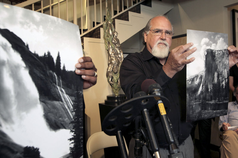 Rick Norsigian holds up a photograph made from an Ansel Adams glass negative at a news conference Tuesday in Beverly Hills, Calif. Norsigian bought 65 negatives at a garage sale a decade ago that experts have since authenticated as Adams' work.