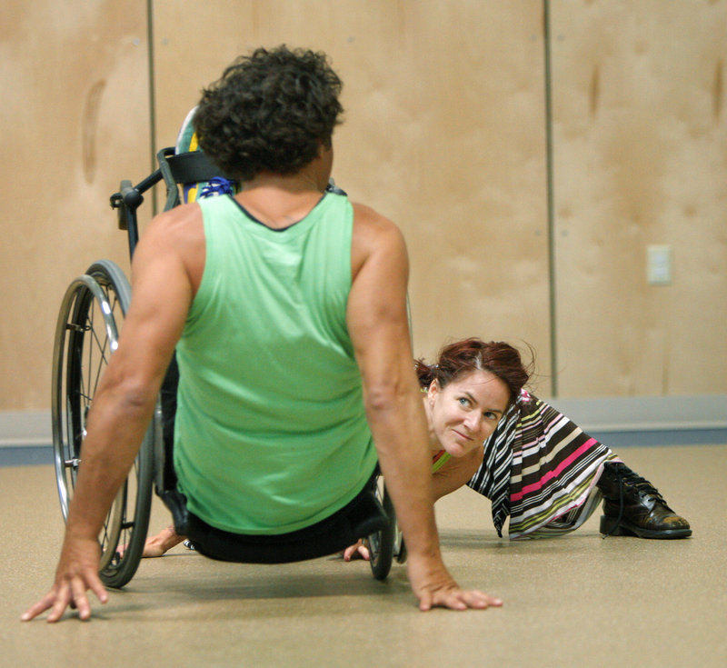 Giles, right, looks to Bell as they perform. They are with Axis Dance Company, which includes dancers with and without disabilities.