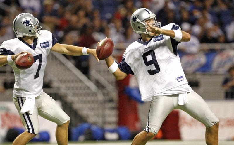 Stephen McGhee, left, and Tony Romo of the Dallas Cowboys get their arms loose Tuesday while working out at the Cowboys' summer training camp at the Alamodome in San Antonio.