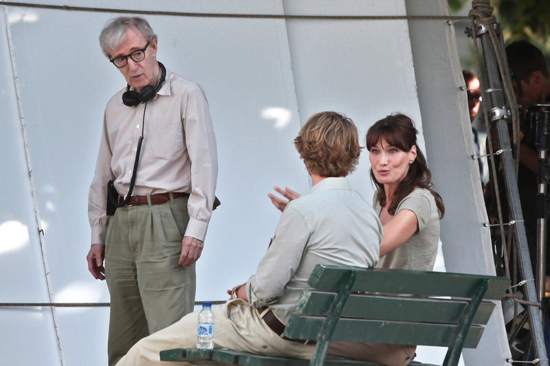 Carla Bruni-Sarkozy, the wife of French President Nicolas Sarkozy, is seen with director Woody Allen, left, and actor Owen Wilson in Paris on Wednesday.