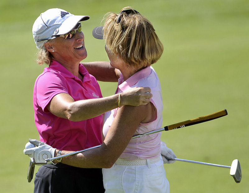 Kristin Kannegieser, left, and Debby Gardner share a hug after Kannegieser held off Gardner in the final round Wednesday for a victory in the WMSGA championship.