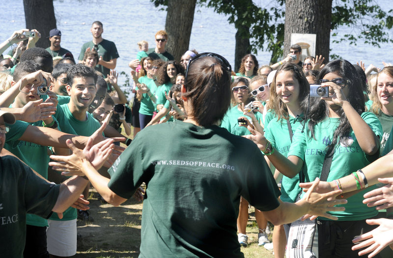 American soccer star Mia Hamm is greeted by campers during her visit to the Seeds of Peace Camp in Otisfield.