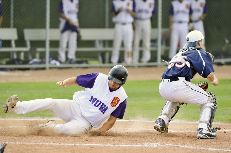 Jamie Ross of Nova Seafood slides across the plate in the third inning Thursday as Bangor catcher Dylan Morris waits for the late throw. Nova Seafood kept rolling with a 12-1 victory.