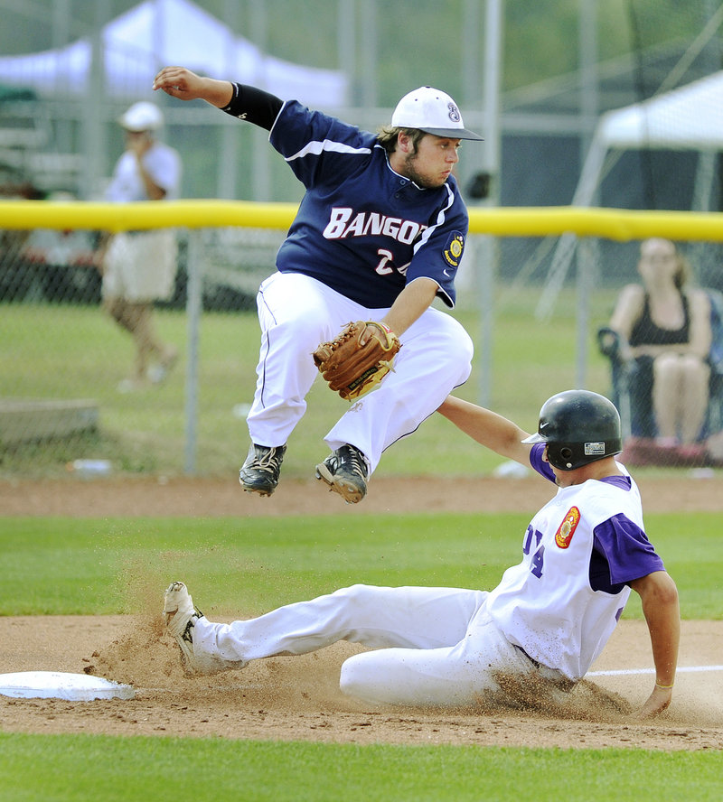 Jamie Ross of Nova Seafood slides safely into third after a passed ball Thursday as Devin Lyshon of Bangor attempts to handle the throw. Nova Seafood won 12-1 in the American Legion state tournament.
