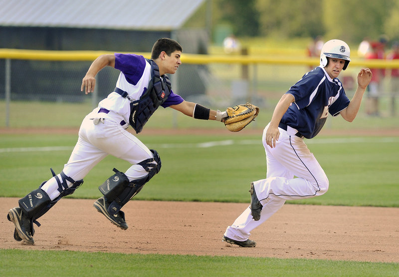 John Miranda of Nova Seafood runs down Nathan Lewis of Bangor between second and third base in the third inning.
