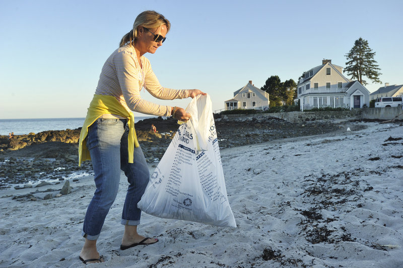 Jacqueline Chauvin, a summer resident of Kennebunk Beach, participates in a beach cleanup marking the 100th anniversary of the Kennebunk Beach Improvement Association on Friday. The association was established in 1910.