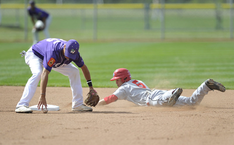 Nick Colucci of Nova Seafood picks up the ball in time to tag out Alex Wong of Gayton Post, who slid past the bag while attempting to steal second. Gayton earned a spot in the championship round with an 8-7 victory.