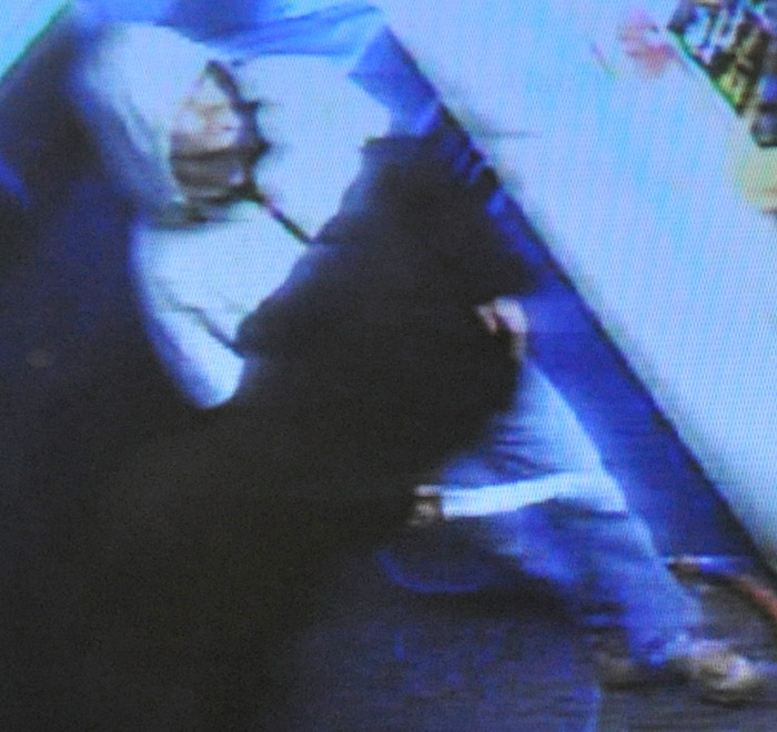 Surveillance photo of a man suspected of robbing the Scrub a Dub car wash Tuesday night
