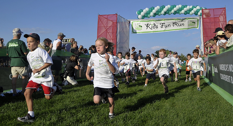 Nick Stinson, 6, left, leads the pack of 5- and 6-year-olds during that age group's heat of the TD Bank Beach to Beacon Kids Fun Run at Fort Williams Park in Cape Elizabeth on Friday. Participants had to run around the entire track during the competition.