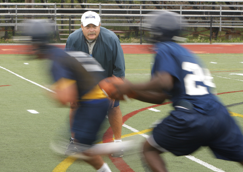 Mike Bailey, Portland High's longtime football coach, watches his players run a play during a practice Monday at Fitzpatrick Stadium.