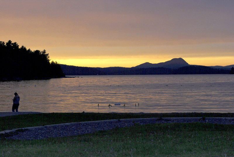 The sun sets behind Borestone Mountain and over Sebec Lake at Peaks-Kenny State Park in Dover-Foxcroft. Park employee Isaac Crabtree said locals regularly drive into the park to see the stunning sunsets.