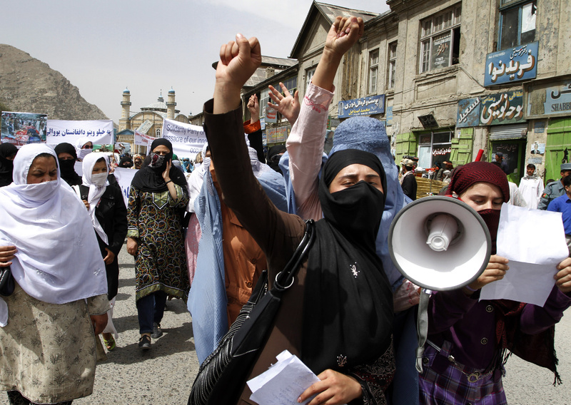 Afghan women chant slogans against NATO and U.S. forces condemning the alleged killing of 52 civilians by NATO and U.S. forces in Afghanistan, during a demonstration in Kabul on Sunday. NATO has repeatedly disputed the allegations of civilian deaths.