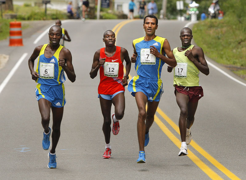 As they near the entrance to Fort Williams Park this morning, Gebre Gebremariam, No. 7, leads a small pack of elite runners including Wilson Chebet (6), Stephen Kipkosgei-Kibet (12) and Alan Kiprono (17). Gebremariam won the TD Bank Beach to Beacon race with a time of 27 minutes, 40 seconds.