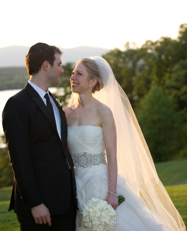 Chelsea Clinton and Marc Mezvinsky are seen during their wedding Saturday at an elegant Hudson River estate called Astor Courts in Rhinebeck, N.Y.